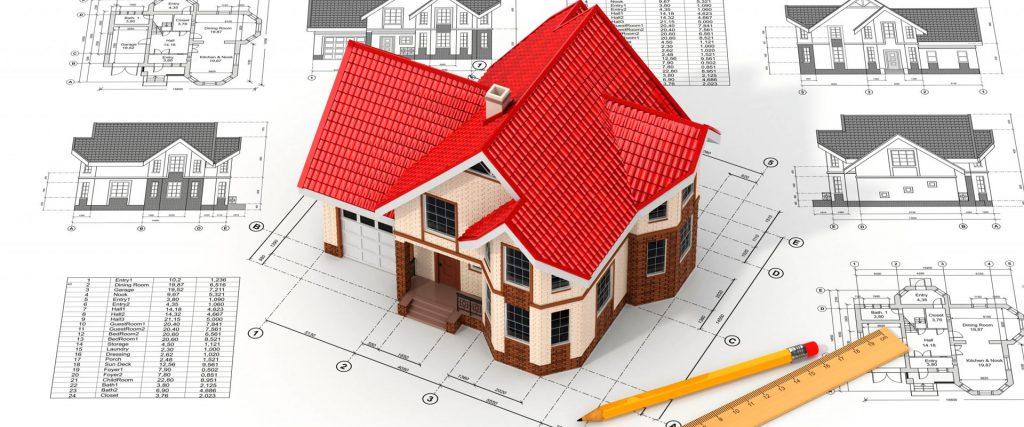 объёмная модель дома стоит на чертеже рядом с карандашом и линейкой